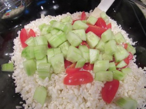 Add cucumber and tomatoes